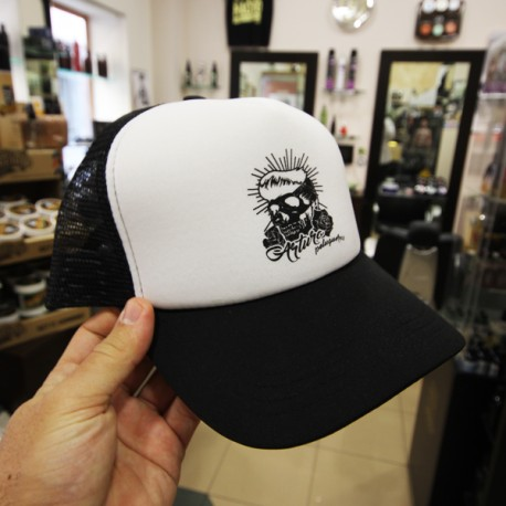 Gorra de Arturo Peluqueros